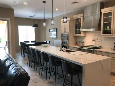View of island and eat in kitchen with table for family dinners