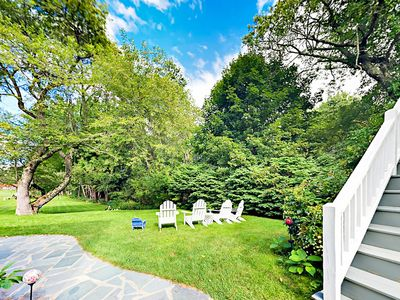 Yard - Soak up the sun from a chaise lounger on the lush lawn.