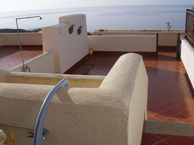 Photo for Beach house with terrace overlooking the beach of Portu Maga