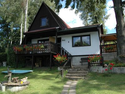 Photo for Cozy log cabin at the feet of the mountain Ještěd, just 600 meters from the lake
