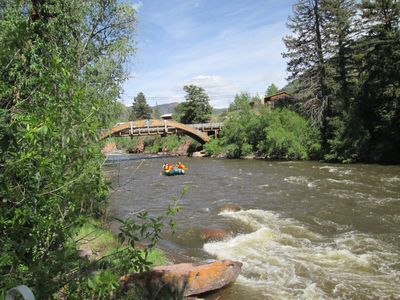 RAFTERS heading down The Roaring Fork passing home