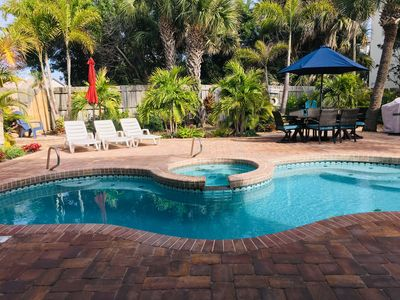 Large landscaped fenced garden with heated pool and spa, gas BBQ and dining
