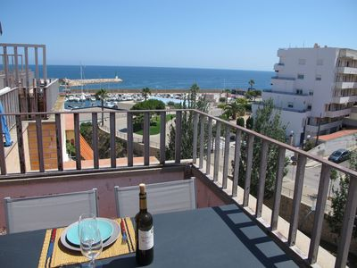 Photo for Charming apartment with large terrace and harbor view