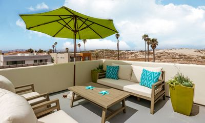 Photo for 4BR w/ Rooftop Deck, Fire Pit & Foosball – Pedestrian Walkway to Beach