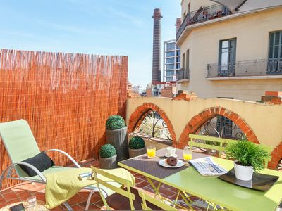 Photo for Designer penthouse with private terrace 5 minutes from Las Ramblas