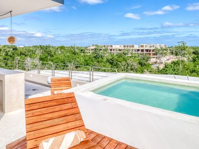 Photo for Spacious home in Tulum jungles w/ shared pool, private rooftop, & balcony views!