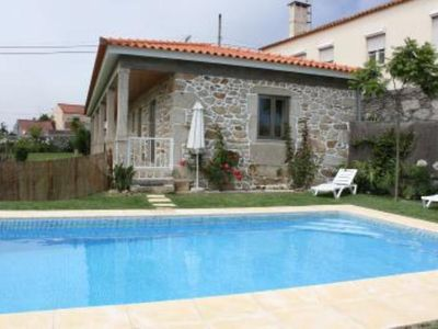 Photo for Cottage with garden and swimming pool - ESPOSENDE