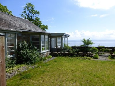 Photo for An idyllic seaside cottage right on the beach with stunning views.  The most perfect position for a
