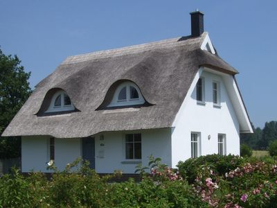 Photo for Family holidays in Thatched Cottage, moody nature, quiet and close to the beach