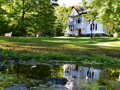 Photo for Quietly set back from West Main Street in an inviting woodland setting.