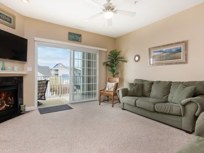 Photo for Spacious, downtown condo w/ a full kitchen & gas fireplace - close to the beach