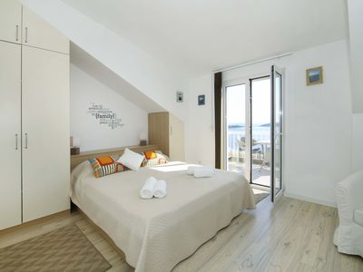 Photo for A beautifully positioned one bedroom apartment in a tranquil oasis of Hvar town.