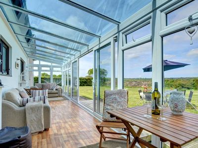 Photo for Tastefully decorated holiday home with bright conservatory and view of the country estate