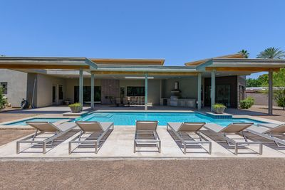 New pool and spa (heated in winter!) surrounded by sunny deck & outdoor kitchen
