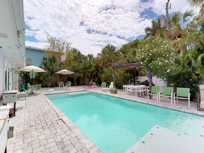 Photo for Dog-friendly duplex w/ shared heated pool - one block to the beach
