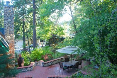 Top deck view looks out at lake, Dining area w BBQ, 4 spacious outdoor decks,
