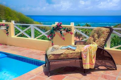 Wake to a gorgeous view of the Caribbean and the private courtyard-enclosed pool