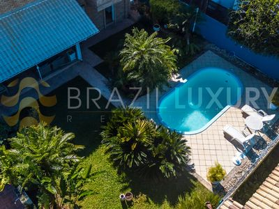 Photo for Next to the beach with pool, BBQ and gardens