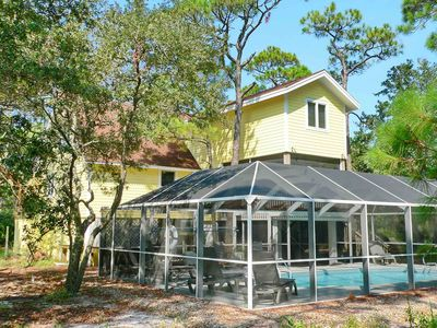"Photo for Ready After Hurricane Michael! FREE BEACH GEAR! Pool, Screen Porch, Wi-Fi, 4 BR/2. BA ""Island Perspective"""