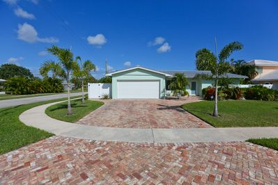 large driveway, beautifully landscaped yard, privacy fence surrounding exterior.