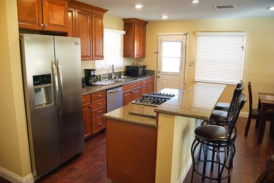 Kitchen and Bar, with New Appliances, Granite and Kitchenware