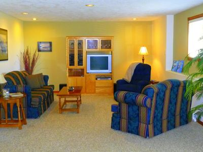 Bright living room with T.V., DVD player, and stereo