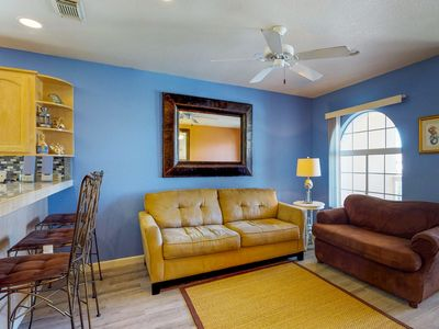 Photo for Cheery condo w/shared pool within walking distance of beach!
