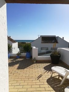 Photo for Duplex with terrace overlooking the sea, next to the beach