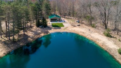 Photo for In the Woods: 2 BR Cabin in Manistee Nat. Forest w/ Private Pond! (Sleeps 7)