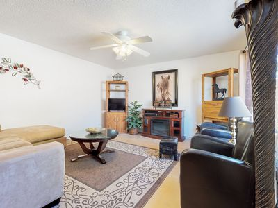 Photo for Comfortable condo w/ patio, shared pools/hot tub & quick access to freeways!