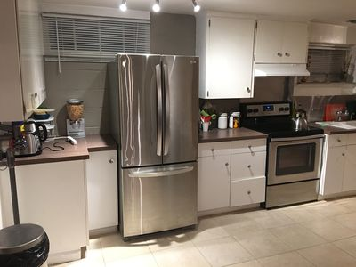 Kitchen with 4 burner stove and oven, toaster, electric kettle etc