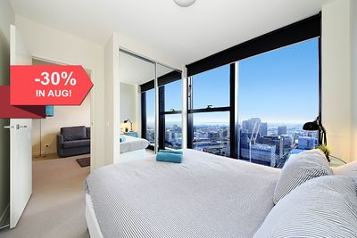 A bedroom with a queen sized bed, plush pillows & a view to die for.