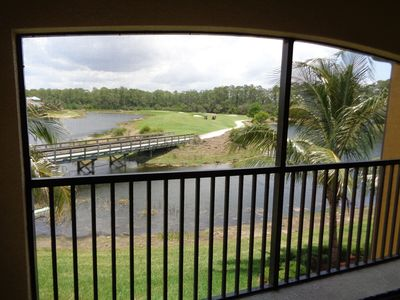 View of lake, bridge and golf course from the rear lanai.