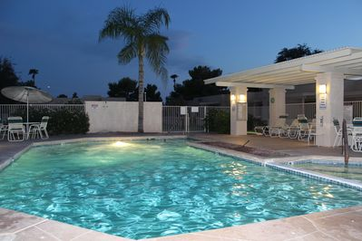 pool at night- heated with hot tub
