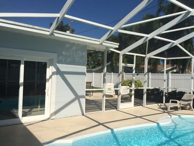 Screened in pool and open patio
