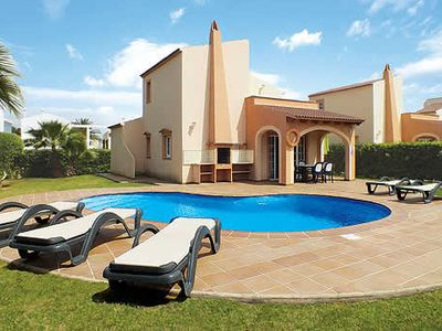 Photo for Centrally located villa with pool access and Wi-Fi for fun and relaxation