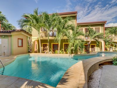 Photo for Quaint, stylish condo with shared pool - walk to dining and the beach!