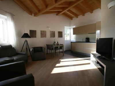 Photo for APARTMENT BREATHTAKING LAKE VIEW, SAUNA, POOL 6 BEDS