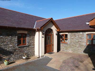 Photo for Be guaranteed of a warm Welsh welcome at Blaenlli. This comfortable cottage enjoys spectacular views
