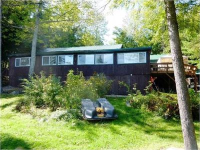 Photo for Three bedroom duplex with a private dock and sandy swim area.