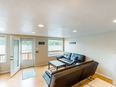 Photo for NEW LISTING! Secluded, lakefront getaway w/ a full kitchen & furnished deck