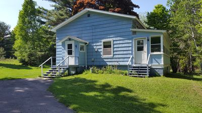 Photo for This clean home is located just 2 miles from Michigan Tech on a secluded lot.