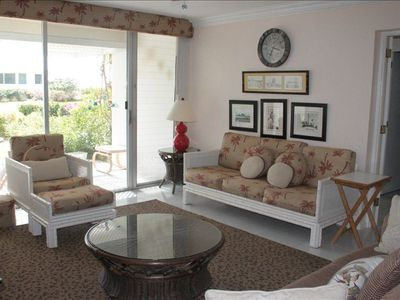 Spacious living room with great views of tropical garden, pool and sea