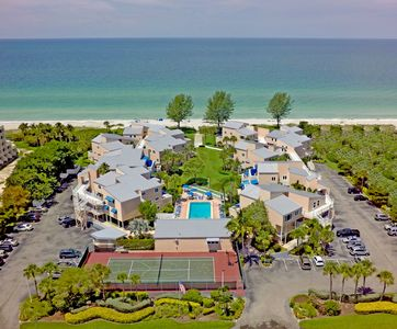 Beach front resort with tennis court, heated pool, and shuffle board.