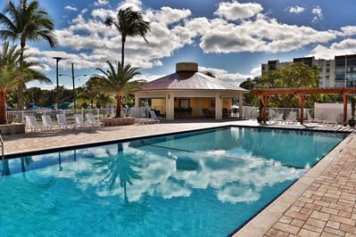 Our heated community pool at Futura Yacht Club w/ Gazebo and plenty of lounges!