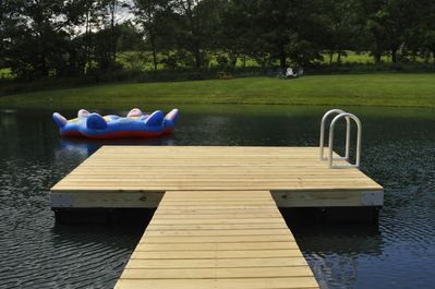 New dock with swim ladder and inflatable float on the pond.