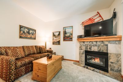 Living Room - Comfortable pull-out bed for kids or 3rd couple, flatscreen TV with Chromecast and satellite channels, cozy fireplace.