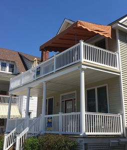 Photo for 4 bedroom/2 bath updated top floor with 3 DECKS just 7 houses from the beach!