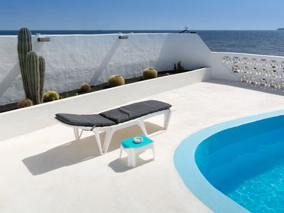 Photo for Eco-Friendly Home Directly on the Coast with Saltwater Pool, Terrace & Wi-Fi