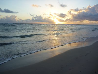 Sunrise over gentle waves right in front of the condo
